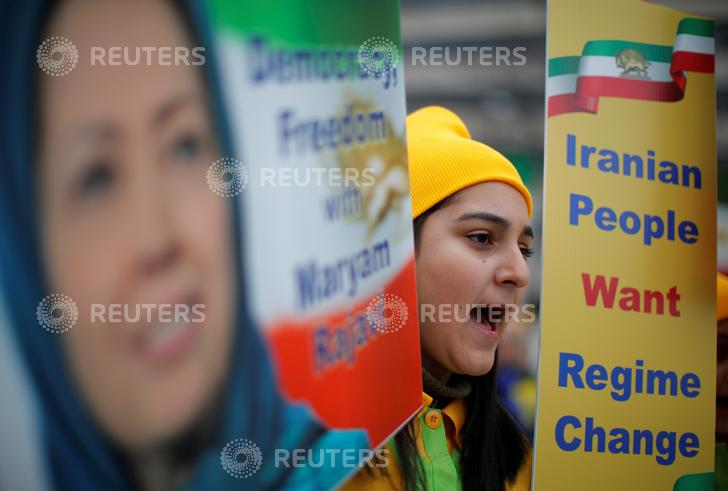 Protestors gather for an Organization of Iranian-American Communities' rally in support of the government change in Iran in Washington